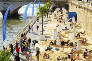 Paris, France - August 13, 2014: The public beach on the banks of the River Seine in Paris. Paris is one of the most popular tourist destinations in Europe.