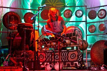 Toney Vacca drumming on stage.