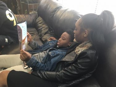 Woman reads to young boy