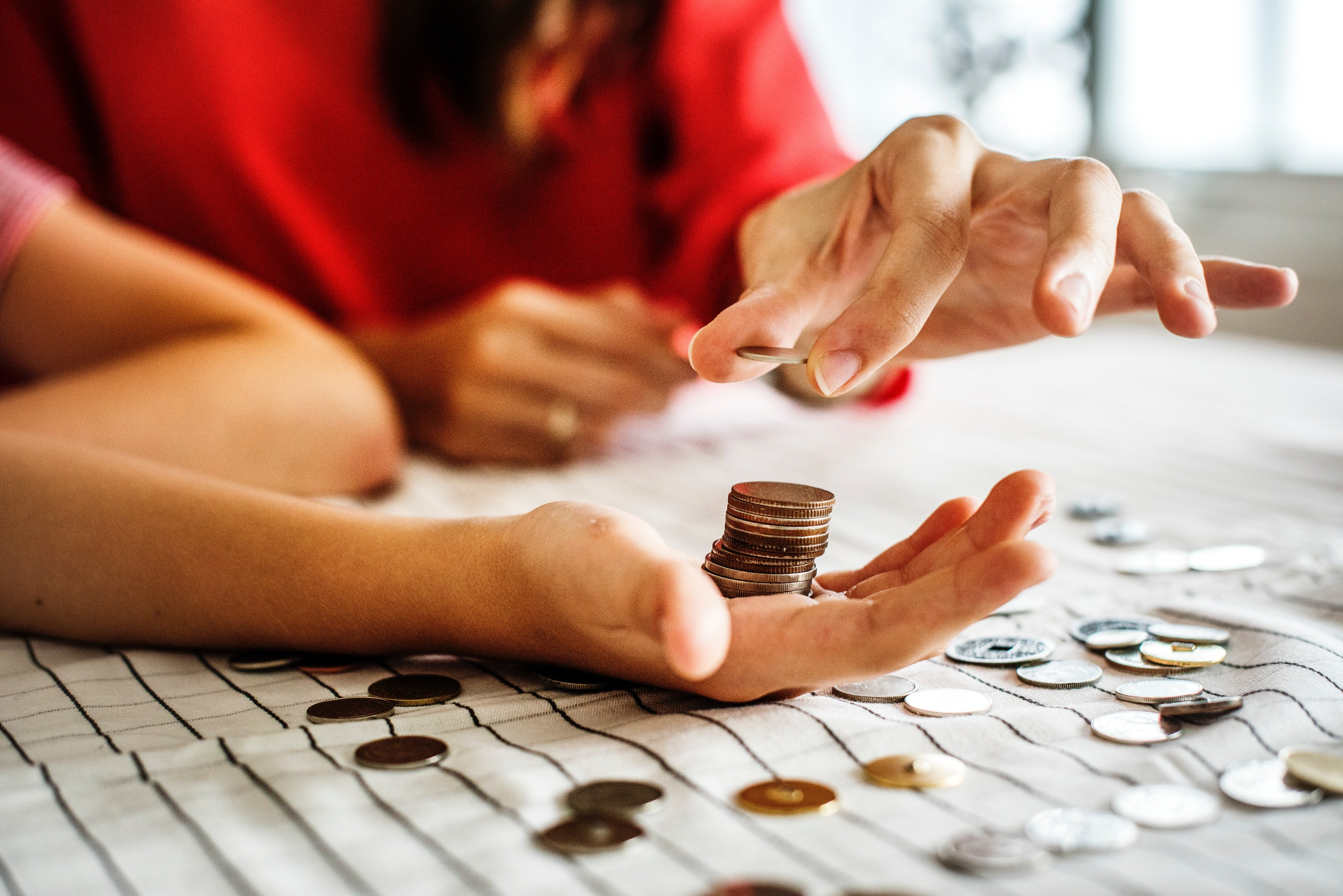 Person counting pennies in their hands.