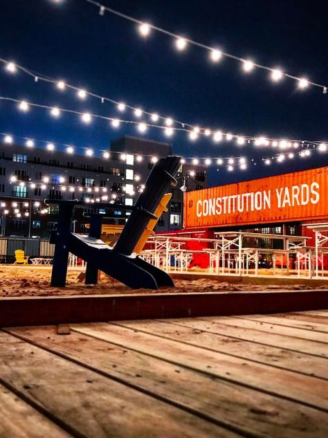 A nighttime shot of Constitution Yards