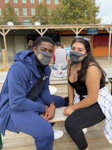 couple posing with masks